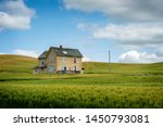 Abandoned Farmhouse In A Wheat...