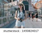smiling woman traveler in hat... | Shutterstock . vector #1450824017