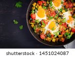 late breakfast   fried eggs... | Shutterstock . vector #1451024087