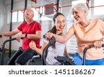senior couple biking at the gym ...   Shutterstock . vector #1451186267