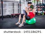 senior man with trainer doing...   Shutterstock . vector #1451186291