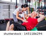 senior man with trainer doing...   Shutterstock . vector #1451186294