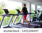full male runs on a treadmill...   Shutterstock . vector #1451246447