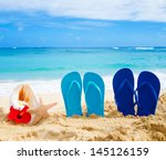 flip flops  seashell and... | Shutterstock . vector #145126159