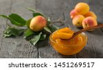apricot jam on a background of... | Shutterstock . vector #1451269517