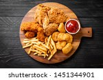 Small photo of fried chicken with french fries and nuggets meal - junk food and unhealthy food