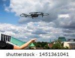 drone landing on hand. drone...   Shutterstock . vector #1451361041