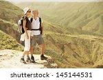 full length of hiking couple... | Shutterstock . vector #145144531