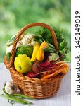 Fresh ripe vegetables in a basket. - stock photo