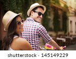 beautiful couple on bicycle in... | Shutterstock . vector #145149229