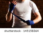 Small photo of fighter is getting ready against brick wall