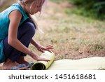 blond caucasian girl rolling...   Shutterstock . vector #1451618681
