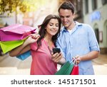 young couple with shopping bag... | Shutterstock . vector #145171501