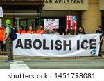 "Small photo of Downtown, Chicago-July 13, 2019: Protest against ICE and Customs and Border Patrol Detention Centers. Group with ""Abolish ICE"" banner."