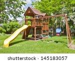 back yard wooden swing set on... | Shutterstock . vector #145183057