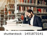 man in a library. guy in a... | Shutterstock . vector #1451873141