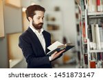 man in a library. guy in a... | Shutterstock . vector #1451873147