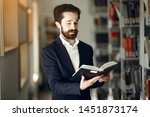 man in a library. guy in a... | Shutterstock . vector #1451873174