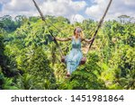 young woman swinging in the... | Shutterstock . vector #1451981864