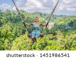 young woman swinging in the... | Shutterstock . vector #1451986541