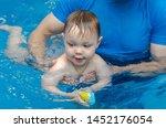 little boy learns to swim in...   Shutterstock . vector #1452176054