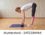 slender young woman unfolds...   Shutterstock . vector #1452186464