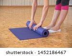 slender young woman unfolds...   Shutterstock . vector #1452186467