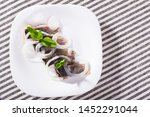 Stock photo image of salted herring with onions on the plate indoors 1452291044