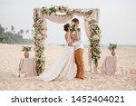 Bride And Groom Enjoying Beach...