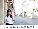 hot cute brunette talking and... | Shutterstock . vector #145246321
