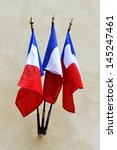 Three National French flags against a wall - stock photo