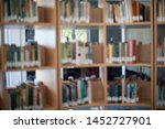 blurred background of books on... | Shutterstock . vector #1452727901