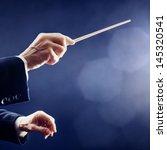 Orchestra Conductor Hands Bato...