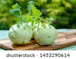 Small photo of Heads of fresh ripe bio white cabbage kohlrabi from organic farm, close up
