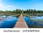 Small photo of Bridge over lake on the way to Neak Pean inside the Angkor Wat Complex, Cambodia