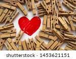 Red heart surrounded by wooden...
