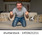 30s or 40s football fan man... | Shutterstock . vector #1453621211