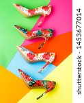 Small photo of Colorful leather shoes stiletto. Bright colored women shoes. Beauty fashion concept, stiletto. Stylish classic women leather shoe. Stylish female shoes in colors. Women shoe on color background.