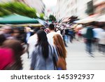 people in the city with zoom...   Shutterstock . vector #145392937