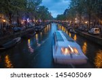 amsterdam   may 11   canal in... | Shutterstock . vector #145405069