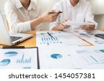 Small photo of Business People Meeting to analyse and discuss and brainstorming the financial report chart data in office, Financial advisor teamwork and accounting concept