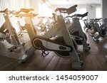 Stock photo modern gym interior with equipment fitness club with row of training exercise bikes healthy 1454059007