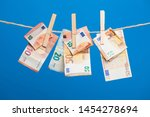 money hung on a string and held ... | Shutterstock . vector #1454278694
