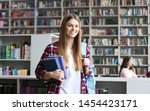young pretty woman with books...   Shutterstock . vector #1454423171