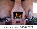 Fireplace On A Summer Kitchen....