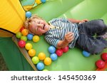 2 year old boy smiling on an... | Shutterstock . vector #145450369