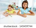 diligent pupils being busy... | Shutterstock . vector #145459744