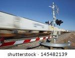 Train Passing Level Crossing...