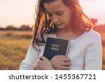 Christian Teenage Girl Holds...