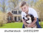 Happy Young Boy And His Dog In...